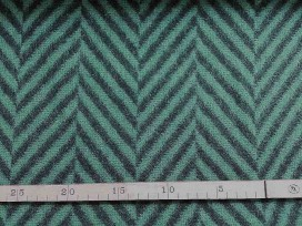 Een dikke wol/polyester stof, donkergroen met een grote zwarte visgraat van ongeveer 7 cm.