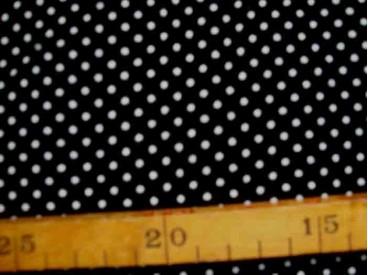 Zwarte soepelvallende babyrib corduroy met kleine witte stipjes . 100% katoen 1.45 meter. breed 145 gr/m2 21 Wales