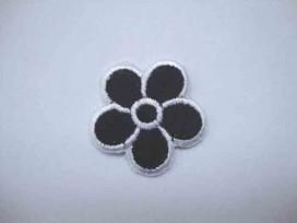 Zwarte bloem applicatie met wit randje