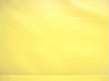 Kunstleer. Mooie kwaliteit kanariegele skai. Kunstleer 75% pu/ 25% pl 1.37 mtr.br. 520 gr./M2