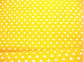 Een gele katoen met een mini wit hartje met een doorsnee van 6 mm. 100% katoen 1.45 mtr.br.