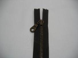 Donkerbruine deelbare antiek messing rits 55 cm. lang