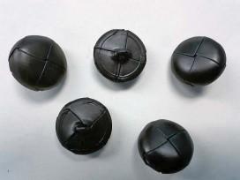 Zwarte leerknoop. 26 mm. doorsnee.