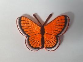 Een opstrijkbare vlinder applicatie van 5 x 3 cm. Neon oranje